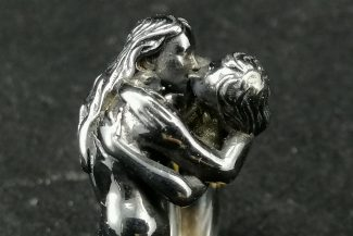 Nude woman couple kissing ring