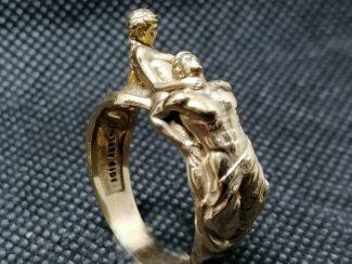 Woman choking her man ring