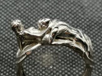 Woman choking man ring